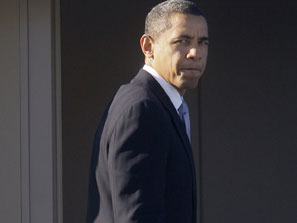 Obama looks back over shoulder