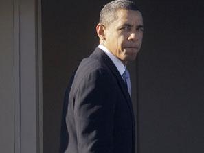 Obama looks back over shoulder